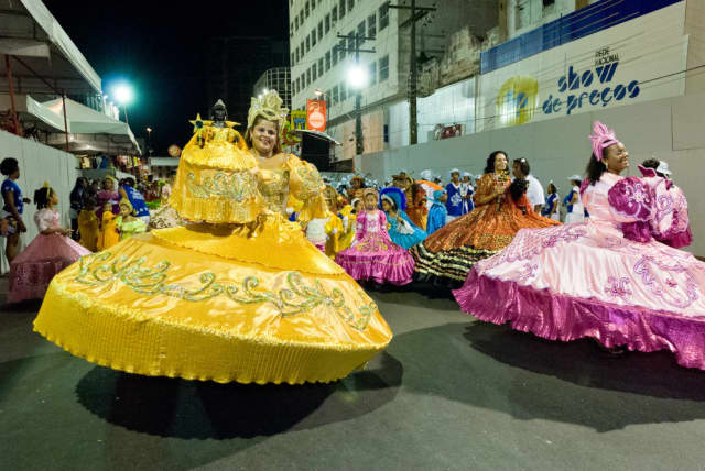 The colorful and traditional costumes for Maracatu drumming and dancing as they perform A Tale of Two Nations featuring Maracatu Nação Estrela Brilhante and Nation Beat.