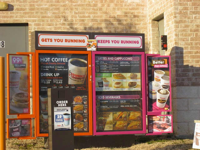 A Fort Lee couple is suing Dunkin' Donuts for overcharging customers in New York and New Jersey.
