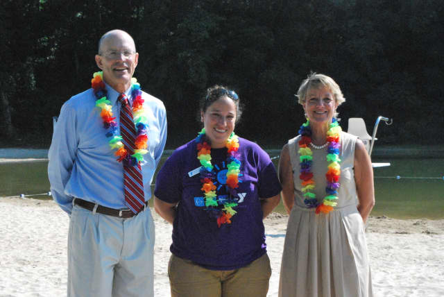 Craig Panzano, executive director of New Canaan YMCA, Davie Cedela, youth and family director of New Canaan YMCA, Gail Donovan, branch manager of Bank of New Canaan are ready for Friday's luau.