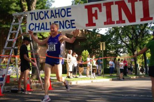 Runners completing the Tuckahoe Challenge Road Race in years past.