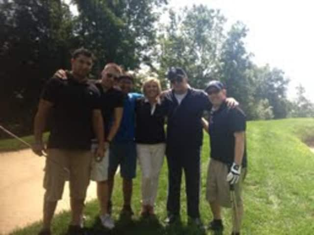 Former Yankees player Joe Pepitone, second from right, stands with the staff of Augie's Prime Cut Restaurant for the Autism Speaks Foundation at Hollow Brook Golf Course in Cortlandt Manor.