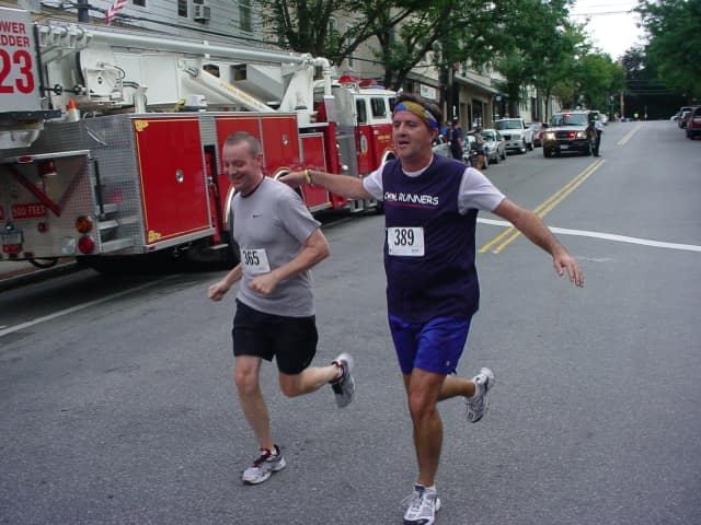 Runners roll down Main Street during a Dobbs Ferry 5-Kilometer race that will be held on Labor Day.