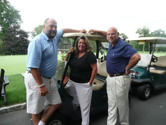 Golf Committee Chair Nick Lee, Fairfield County Bank Vice President Carol Johnson, and Frank Rowella of Reynolds and Rowella.