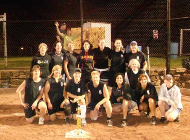 Fifty Coins Restaurant poses with its 2013 Ridgefield Women's Softball championship trophy after a 9-8 victory.
