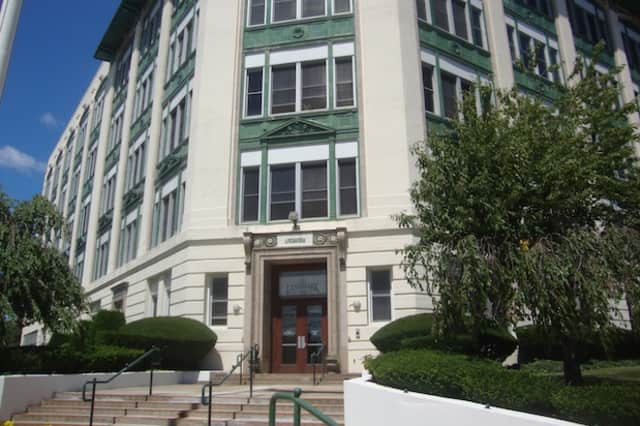 Residents of the Landmark condominium building are upset that Port Chester's Building Department is preventing them from selling their homes.
