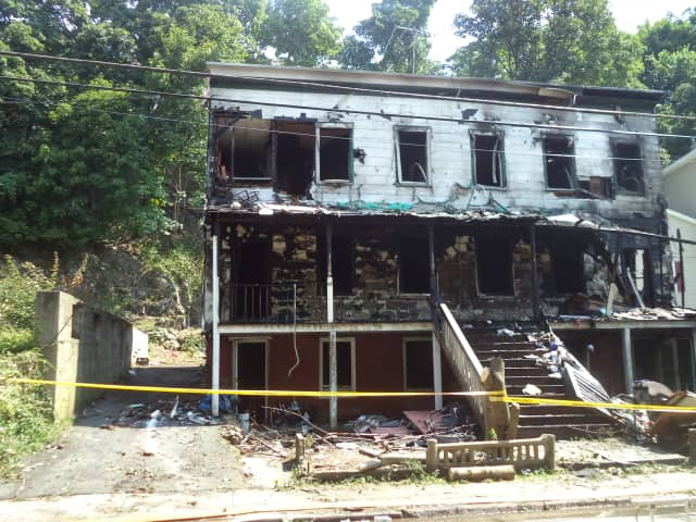 A two family home at 49 Hunter Street will be torn down after a fire early Wednesday morning.