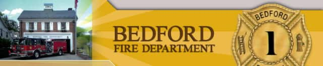 Firefighters are dealing with an active fire at Old Post Road in Bedford.