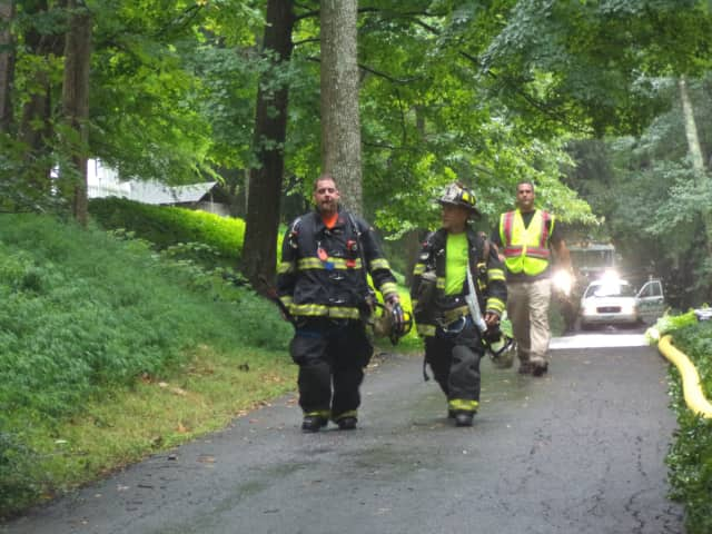 Bedford firefighters leaving the scene after battling a propane fire on Old Post Road.