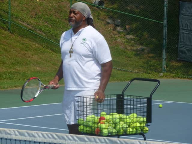 """Tennis instructor Joe Boykin serves and volleys with players at the """"Celebrate Greenburgh"""" tennis event."""