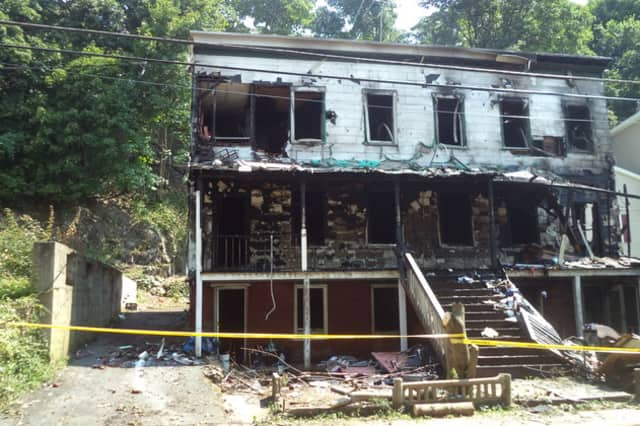 A two-family home at 49 Hunter St. was torn down after a fire early Wednesday morning.
