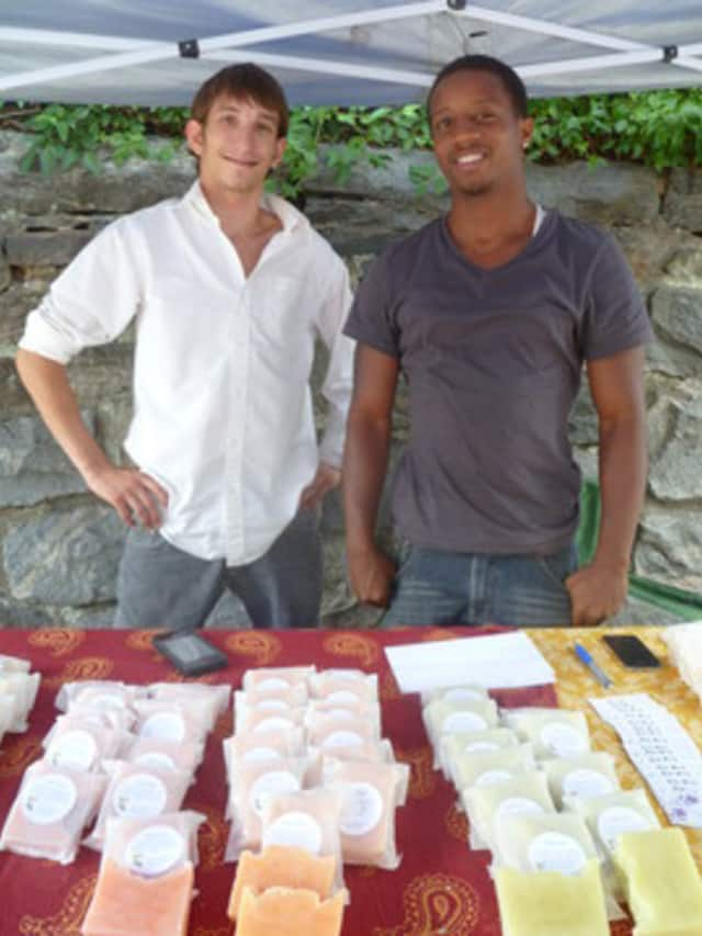 "Jordan DeJong, left, the founder and president of ""Hope Soaps"", and his friend Sean Jones at the Dobbs Ferry Farmers Market."