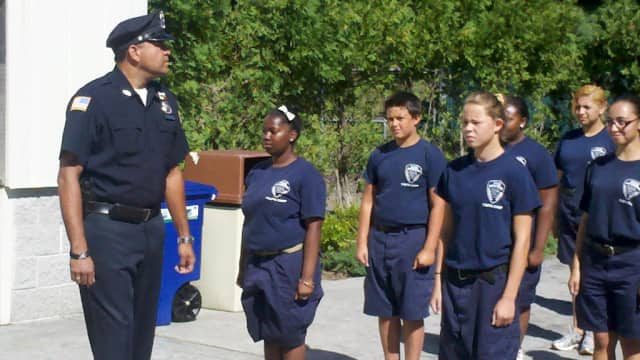 Greenburgh Police Officer David Zenon, a Summer Youth Camp instructor. put his cadets through their paces at graduation.