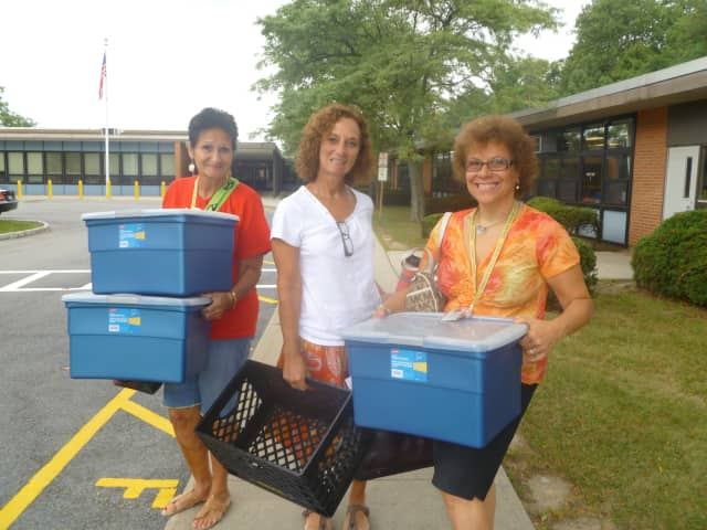 Ardsley Schools Special Education teachers (from left) Rosemarie Mostacciuolo, Janine Maruccia and Rosemarie Fata, getting the prep work done before school begins Tuesday.