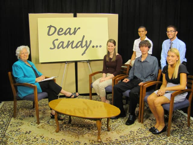"""Assemblywoman Sandy Galef (far left) with five of her recent interns, Jeffrey Guzman (back left), Ross Beroff (back right), Alanna Powers (front left), Brendan Zarkower (front center) and Cat Purdy (front right) on the set of """"Dear Sandy."""""""