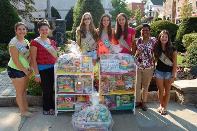 The Tuckahoe Girl Scouts donated books, book cases and new toys to the Andrus Early Learning Center recently.