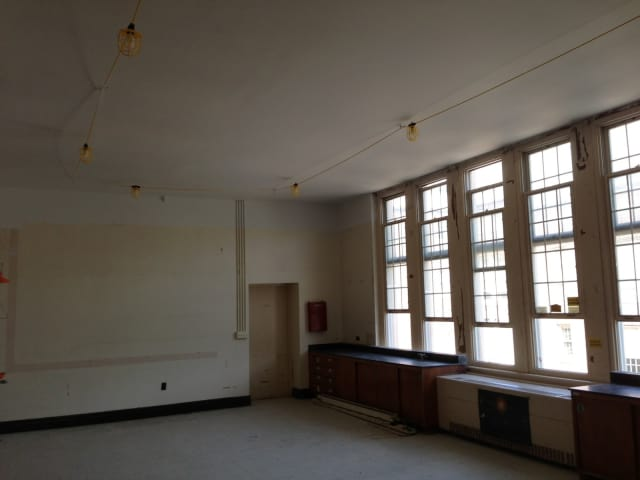 A temporary classroom that has been arranged in the Bronxville Middle School, featuring temporary lights.