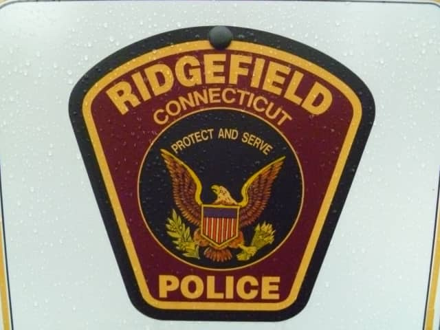 An 80-year-old Ridgefield resident turned herself in to police in connection with a fatal motorcycle accident in July.