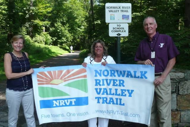 Patricia Sesto, NRVT Chairperson; Carol Johnson, Wilton Alliance for a Healthy Community Co-Chair; Bob McDowell, Executive Director of the Wilton Family Y stand near the Wilton portion of the Norwalk River Valley Trail.