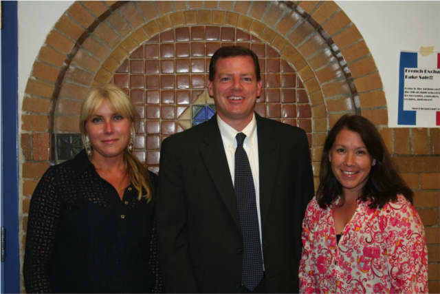 Timothy McGrath and Nancy Yu Kochansky pose with Bronxville School Foundation member Jill Pytosh.