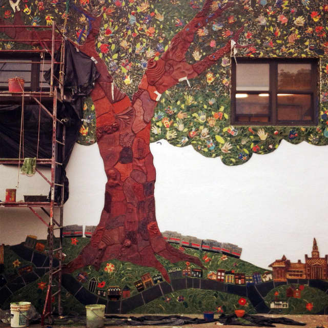 A new mural outside of the Clay Art Center was unveiled last week.
