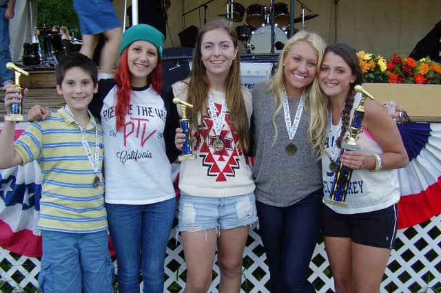 From left, Thomas Dalceredo, Taylor Headrick, Kristyn Hatley, Kayla Lonergan, and Becca Thompson show their Yorktown Grange Fair karaoke contest trophies.