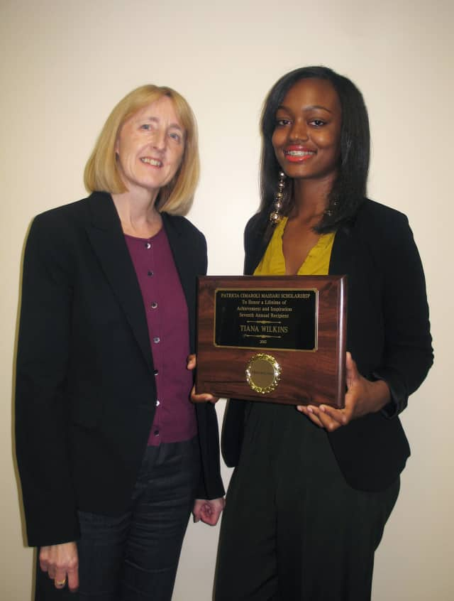 Berkeley College Provost Marianne Vakalis, presents Tiana Wilkins of Ossining with the 2013 Massari Scholarship.