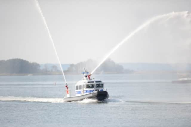 The Greenwich Police Department's new public safety vessel speeds through Greenwich Harbor at its recent commissioning ceremony.