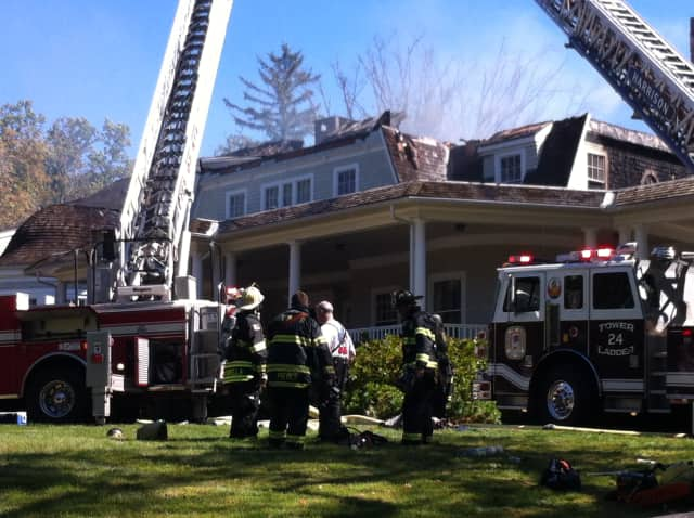 Fire crews are battling a blaze at a home in Rye.