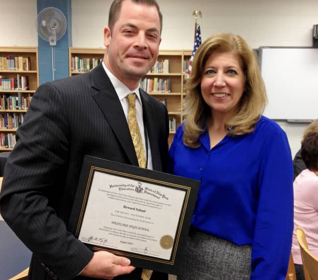 Principal Keith Schenker is presented with the State Education Department certificate recognizing Westlake High School as a high achieving Reward School by Superintendent Dr. Susan Guiney at the September 18 Board of Education meeting.