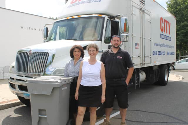 Wilton Library's Shredding Day for the Community organizers Elaine Tai-Lauria and Robin Roscillo check out City Confidential's Shred Truck with driver Chris Pia.