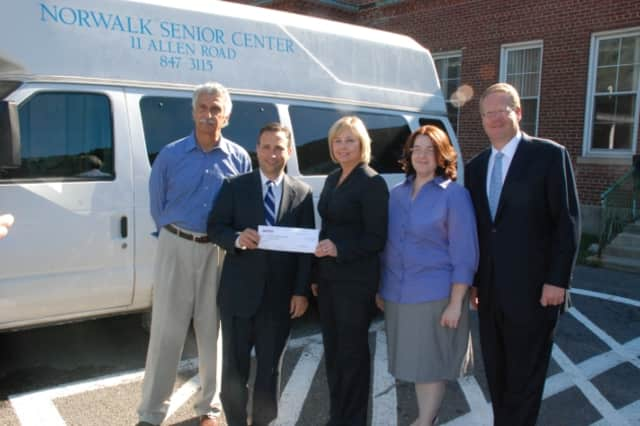 State Sen. Bob Duff (D-Norwalk) joins the Director and board members of the Norwalk Senior Center as an Aetna executive presents a $1,000 check to help the Senior Center recover from a recent act of vandalism.