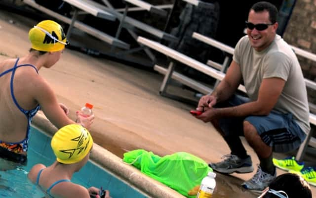Airman 1st Class Lance Thornton coaches his Barracudas swim team at practice in Montgomery, Ala.