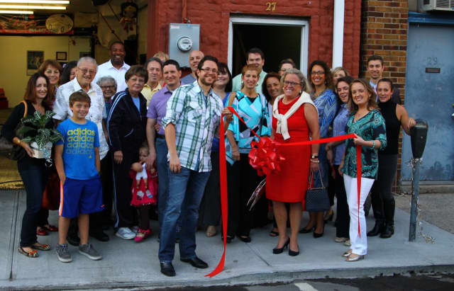 Bronxville Mayor Mary Marvin and members from the chamber of commerce celebrate Lyte Body Fitness.