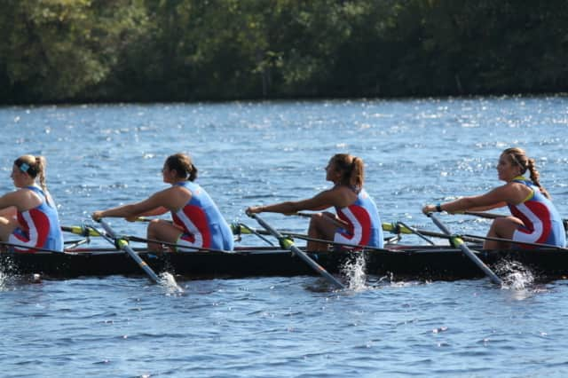Girls on the Norwalk River Rowing Association pull during the Head of the Merrimack regatta last weekend in Massachusetts.