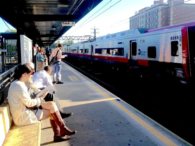 Commuters wait for delayed New Haven line trains at the Mamaroneck Metro-North Station.