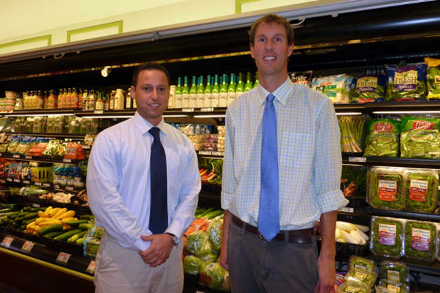 Mike Picheco (left) and Tim Dolnier are the new owners of Village Market in Wilton.