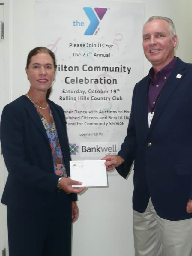 Heidi DeWyngaert, president of Bankwell, and Y Executive Director Bob McDowell announced Bankwell's sponsorship of the 27th Annual Wilton Community Celebration.