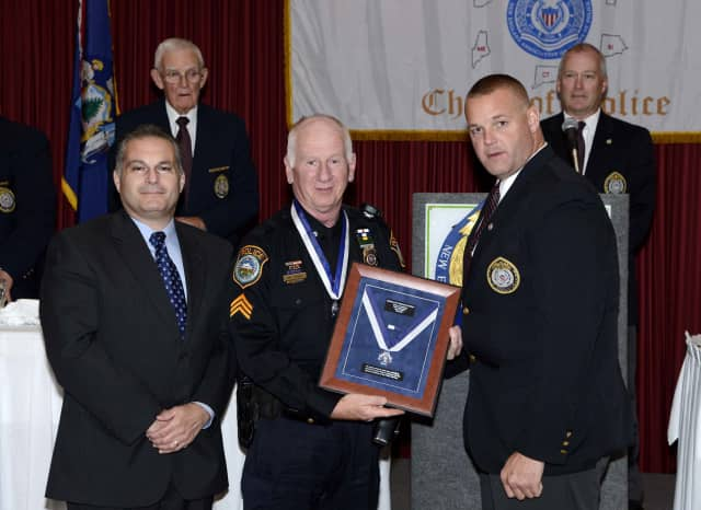 Sergeant Thomas Tunney (center) was awarded the 2013 New England Association of Chiefs of Police Medal of Valor in Plymouth, Mass. last month.