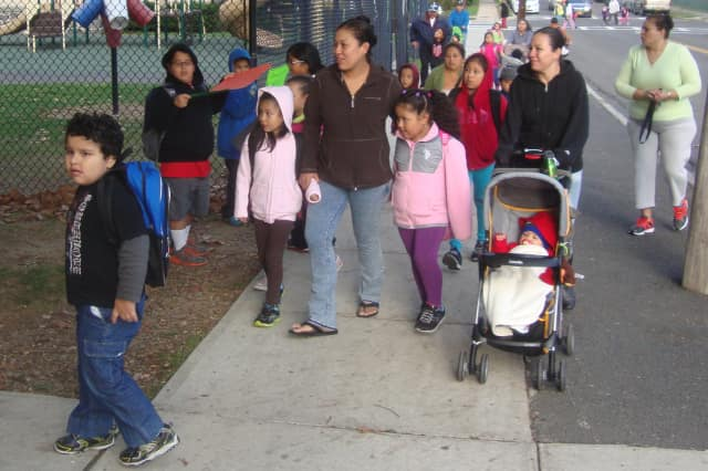 Crowds of students arrive at Thomas A. Edison School with their parents as the district celebrates International Walk to School Day.