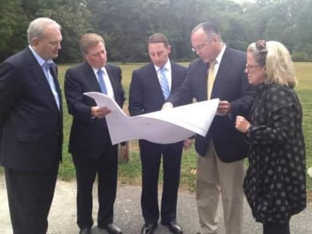 (from left): Bronxville officials David Cyganowski and Joe Pepe look at plans with County Executive Astorino, Supervisor Colavita and Bronxville Mayor Mary Marvin.