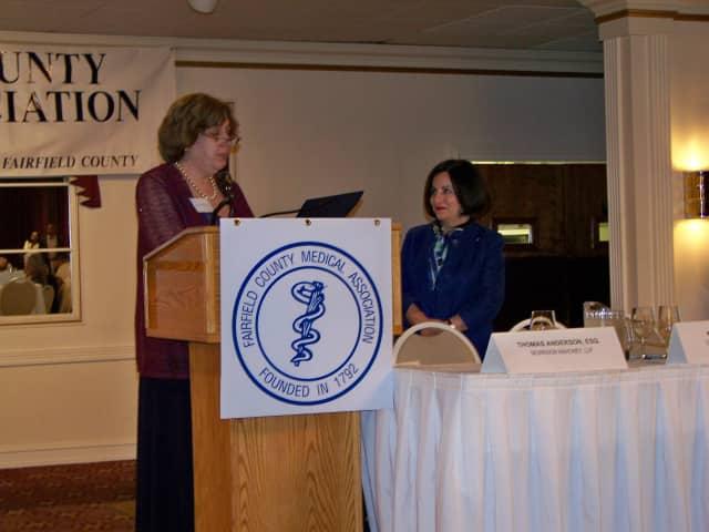 Dr. Robin Oshman, president of FCMA presents Senator Toni Boucher with the Fairfield County Medical Association Legislator of the Year Award.