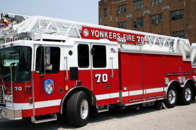 A News 12 van was ablaze outside the Yonkers Courthouse on Tuesday, a report said.