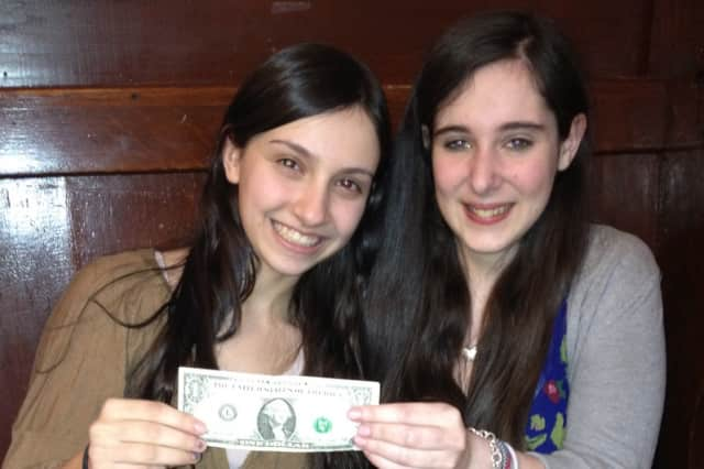 Arielle Joselson of Mamaroneck, left, and Seri Roth of Suffern, classmates at Solomon Schechter Westchester School in Hartsdale, hope their charity, A Dollar Campaign, can help beat pediatric cancer.