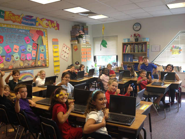 """Fourth-grade students give the new laptops """"Two-thumbs Up!"""""""