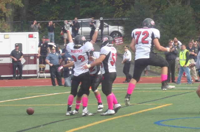 Rye celebrates after Conor Murphy scores a go-ahead touchdown in the fourth quarter of the rivalry game against Harrison Saturday.