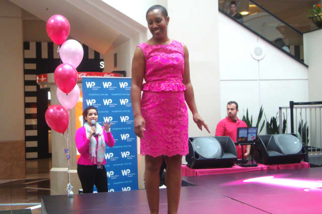 """Breast cancer survivor Crystal Radcliff models a pink dress at the """"Walk for Hope"""" fashion show hosted by White Plains Hospital at the Westchester Saturday."""