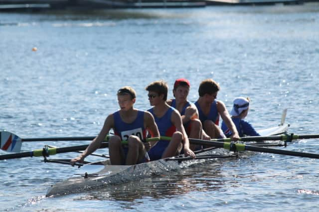 Wilton neighbors Gregory Bauerfeld and Jamie Fagan row take gold in the second varsity four at the Head of the Housatonic