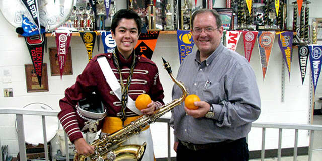 Harrison High School sophomore Philip Milana and Marching Band Director Charlie Briem.