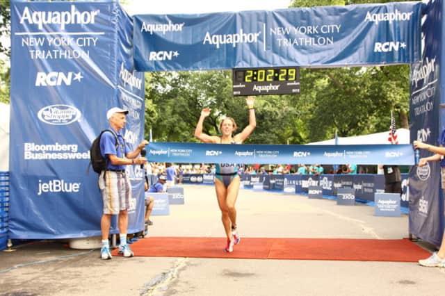 Wilton's Amy Bevilacqua won the women's division of the Men's Health Urbanathlon Sunday in New York.