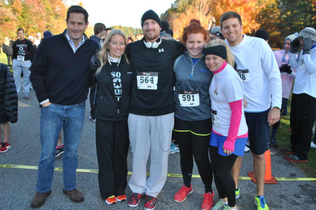 Jason Needle, center, poses with his family and State Sen. Greg Ball, far left, at the first Jason's Army 5K in Yorktown.